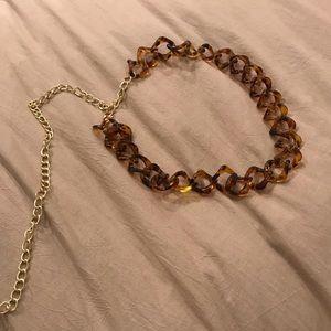 Tortoise ring chain belt